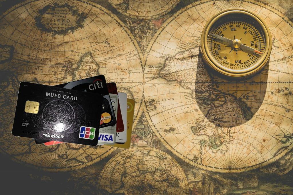 カード比較申し込み2018(古い地図の上にクレジットカードとコンパス)